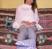Fox ditches her white pumps to expose her feet covered in striped nylons.