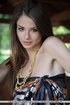 Delightful bony fawn in an animal print wrap gets naked in the shed.