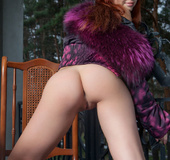 Young redhead in fur jacket and jeans shows soft tits, hot ass and shaved
