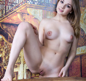 Young nude blonde plays music and models succulent ass, creamy tits and