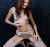 Sexy brunette in white stockings tempts with cute face, sexy ass, tits