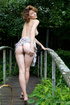 Beautiful damsel strips dress outdoors to rock with spicy boobs, hot cunt