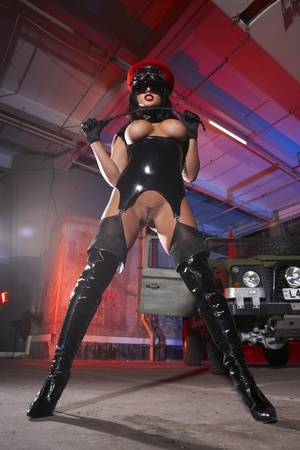 Wild busty brunette in a rubber outfit a - XXX Dessert - Picture 3