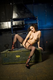 tatted-up brunette riding big