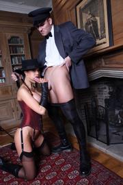 hat-wearing brunette corset gets