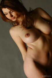 curvaceous redhead looking very