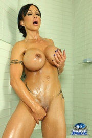 Tattooed Busty Seductress Takes A Shower With Sexy Oiled