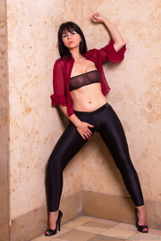 long-haired beauty removes top
