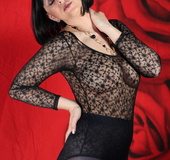 See the pierced nipple of bombshell wearing a black lace leotard and sheer