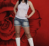 Cutie in white platform boots and jean shorts shows off fancy hosiery
