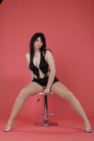 Minx strips down to nude stockings while - XXX Dessert - Picture 7
