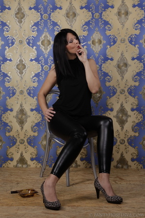 Hot brunette in shiny black leggings is  - XXX Dessert - Picture 2
