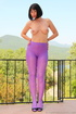 Amazing purple tights on beauty on a balcony who takes off her black top
