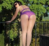 Popping purple panty set taken off brunette on a terrace to unveil a dildo