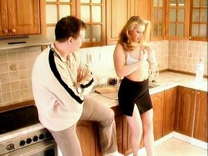 Blonde MILF in a black skirt bends over  - XXX Dessert - Picture 2