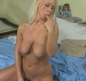 Beautiful maiden fills her cunt with a black toy and a dick in bed.