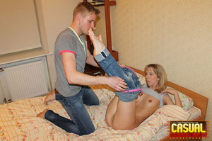 Glamorous blonde whore in a grey shirt and jeans cowgirls a cock on floral sheets. - XXXonXXX - Pic 8