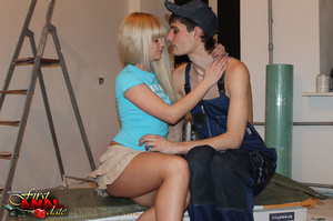 Beautiful diva in a blue shirt and a frilly tan skirt does the painter's cock in the work area. - XXXonXXX - Pic 5