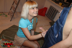 Beautiful diva in a blue shirt and a frilly tan skirt does the painter's cock in the work area. - XXXonXXX - Pic 8