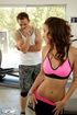 Slutty brunette teen in a yoga suit fucking with her trainer in the gym