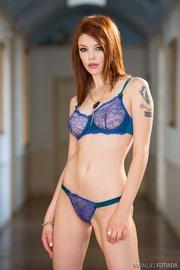 bodacious redhead posing blue