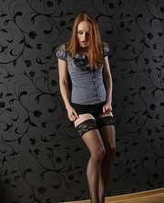 fair-haired bombshell posing black