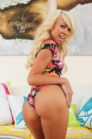 Tanned blonde teen in a vibrant, floral  - XXX Dessert - Picture 5