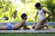 youthful studs kiss beside