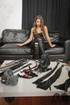 Brunette cougar in leggings and her BDSM tools and mistress torturing