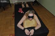stunning filly blindfolded shackled
