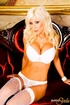 Boobilicious blonde lady in white stockings and lingerie enjoys her silver