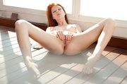 lusty redhead with tight