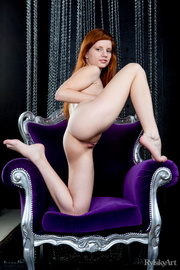 alluring redhead displays her