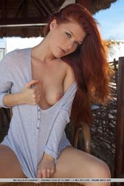 ravishing redhead sheltered from