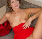 Adorable blue-eyed blonde enveloped in an elegant red dress gets naked