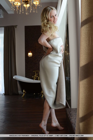 Cheerful blonde isnt wearing clothing wh - XXX Dessert - Picture 1