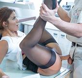 Leggy brunette babe in black stockings gets banged on the office desk