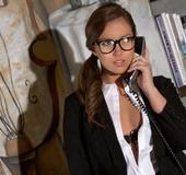 Ponytailed brunette secretary in glasses and black lace lingerie pleasing