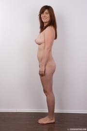 hot redhead posing her