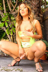 Lustful shemale in a yellow dress flaunting her dick and asshole outdoors