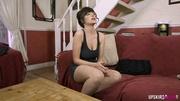 short-haired brunette the sofa