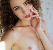 Brunette freshie with wavy hair takes off her nice dress to show off her