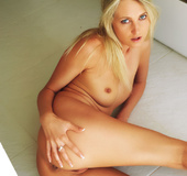 Very hot blonde coed with shaved pussy posing on the bathroom floor