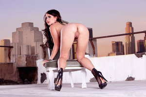 Gorgeous hottie exposes her big round boobs as she pose topless on a rooftop of a building then she takes off her black panty shorts and displays her pussy in different positions wearing her black high heels. - XXXonXXX - Pic 12
