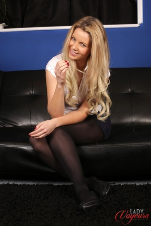 Foxy blonde babe sits on a black sofa we - XXX Dessert - Picture 6