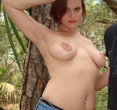 Red babe takes off her jeans and T-shirt and flaunting her shaved pussy