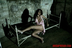 Brunette prisoner in a tattered pink dress gets whipped with a riding crop in her cell. - XXXonXXX - Pic 1