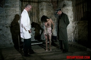 Brunette prisoner in a tattered pink dress gets whipped with a riding crop in her cell. - XXXonXXX - Pic 4