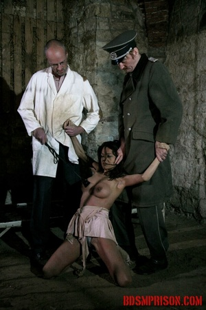 Brunette prisoner in a tattered pink dress gets whipped with a riding crop in her cell. - XXXonXXX - Pic 6