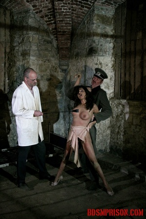 Brunette prisoner in a tattered pink dress gets whipped with a riding crop in her cell. - XXXonXXX - Pic 8
